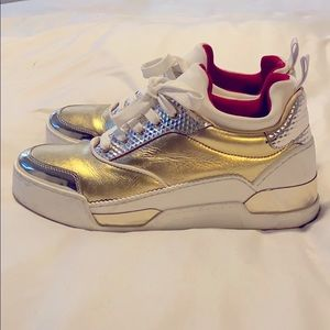 Christian Louboutin gold and red sneaker